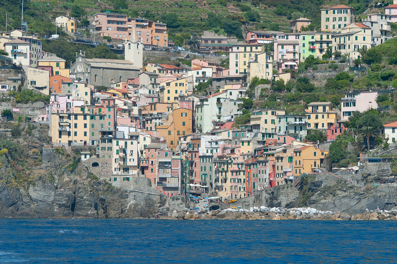 Colorful Riomaggiore houses on a valley in Cinque Terre, Italy