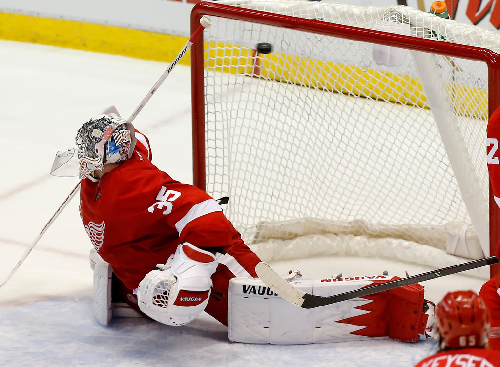 . Detroit Red Wings goalie Jimmy Howard (35) can\'t stop a goal by Colorado Avalanche\'s Andre Benoit during overtime of an NHL hockey game Thursday, March 6, 2014, in Detroit. The Avalanche defeated the Red Wings 3-2. (AP Photo/Duane Burleson)