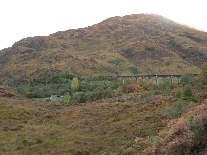 """Glenfinnan (Finnan's Glen) 16 miles from the start. """"The Glenfinnan viaduct built by Robert """"Concrete Bob"""" McAlpine, now recognised as a film location thanks to the Harry Potter movies, is 416 yards long with 21 arches, 100 ft high, and built on a 12 chain curve."""""""