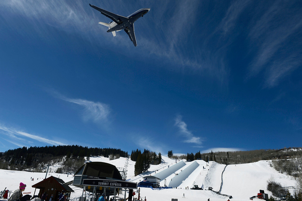 . A jet comes in for a landing at the nearby Aspen/Pitkin County Airport as it flies over the Red Bull double pipe during practice at Buttermilk ski area Friday morning, March 21, 2014. (Photo By Andy Cross / The Denver Post)