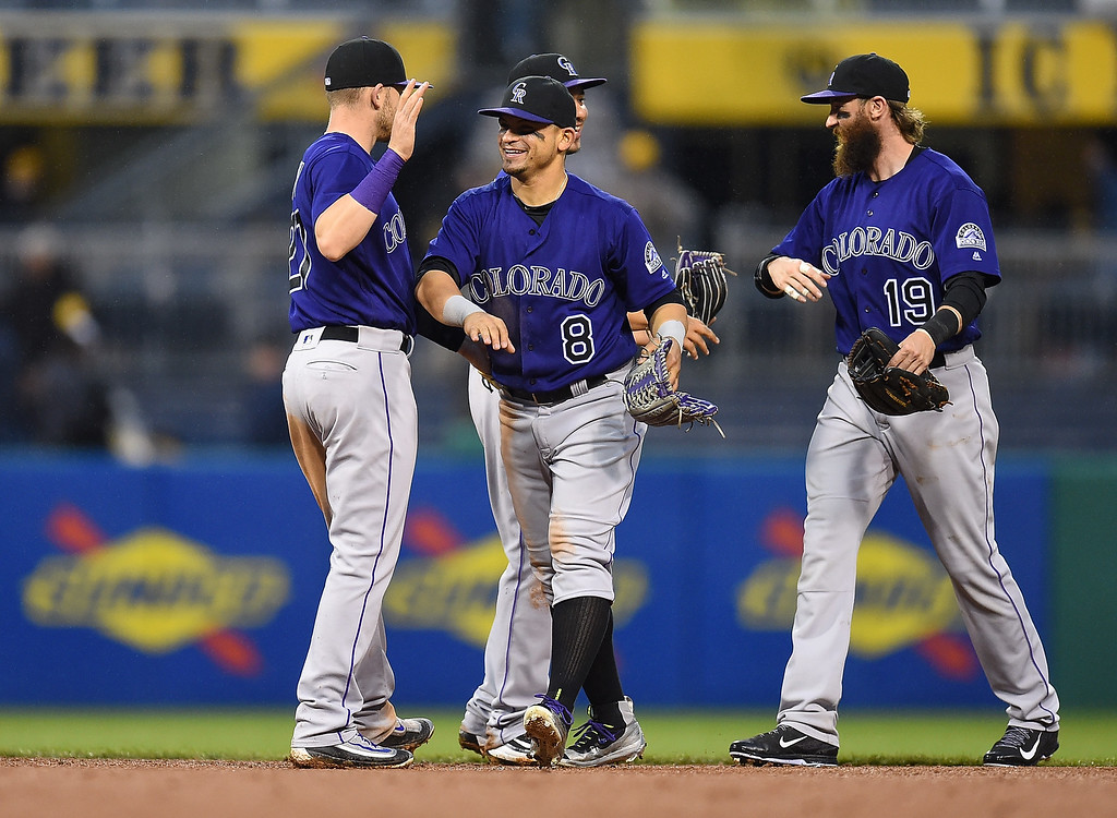 . PITTSBURGH, PA - MAY 21:  Gerardo Parra #8 of the Colorado Rockies celebrates with teammates after a 5-1 win over the Pittsburgh Pirates on May 21, 2016 at PNC Park in Pittsburgh, Pennsylvania.  (Photo by Joe Sargent/Getty Images)