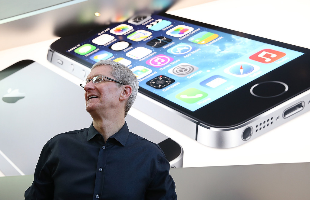 . Apple CEO Tim Cook looks on at an Apple Store on September 20, 2013 in Palo Alto, California.   (Photo by Justin Sullivan/Getty Images)