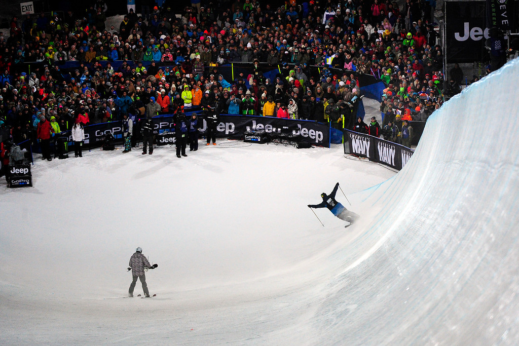 . Davide Wise raises his arms to the crowd after a successful first run at the men\'s ski superpipe final in Aspen at Winter X Games in Aspen, January 24, 2014. Wise went on to win gold in the event. (Photo By Mahala Gaylord/The Denver Post)