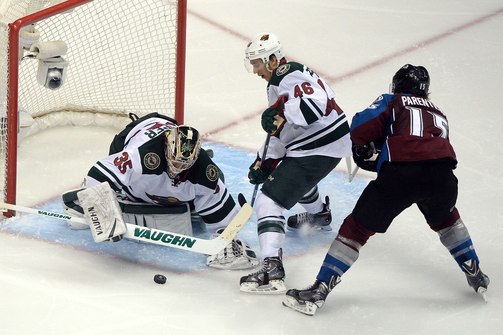 . DENVER, CO - APRIL 26: P.A. Parenteau (15) of the Colorado Avalanche works for a shot as Darcy Kuemper (35) of the Minnesota Wild and Jared Spurgeon (46) defend the net during the third period. The Colorado Avalanche hosted the Minnesota Wild during game five of the first round of the NHL Stanley Cup Playoffs at the Pepsi Center on Saturday, April 26, 2014. (Photo by Karl Gehring/The Denver Post)