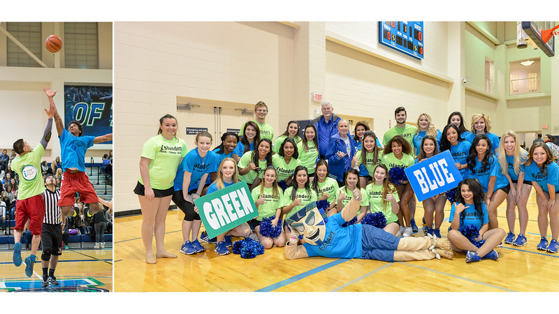 Dr Flavius Killebrew and Kathy Killebrew pose for a picture with the Islander Dance & Cheer Team during the Faculty VS Staff basketball game in the Dugan Wellness Center.