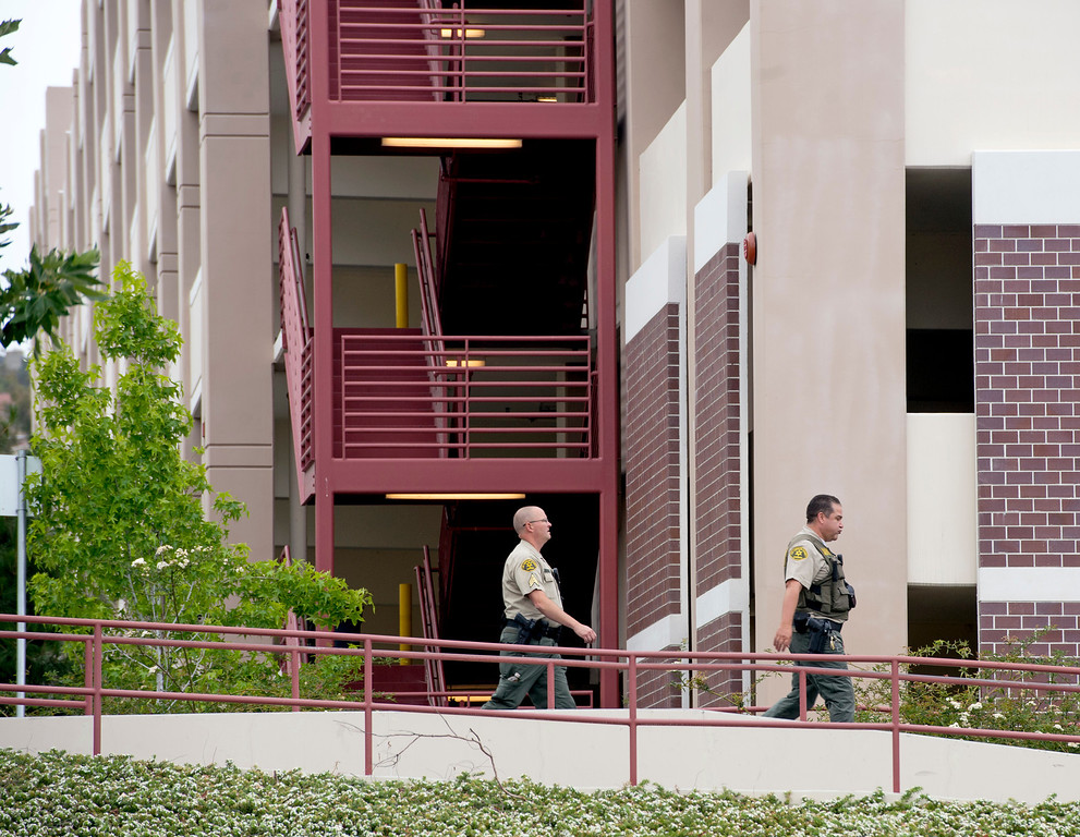 . Los Angeles County Sheriff\'s Deputies,  Security Officers and Los Angeles School Police lockdown East Los Angeles Community College after a man threatened to shoot up that campus as well as Santa Monica Community College May 16, 2013.   (SGVN/Staff photo by Leo Jarzomb)