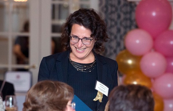 10/10/19 Wesley Bunnell | StaffrrThe CT Breast Health Initiative held their award dinner at Shuttle Meadow Country Club to honor their donors. President and CEO of the American Savings Foundation Maria Falvo smiles at fellow guests as she receives an award.