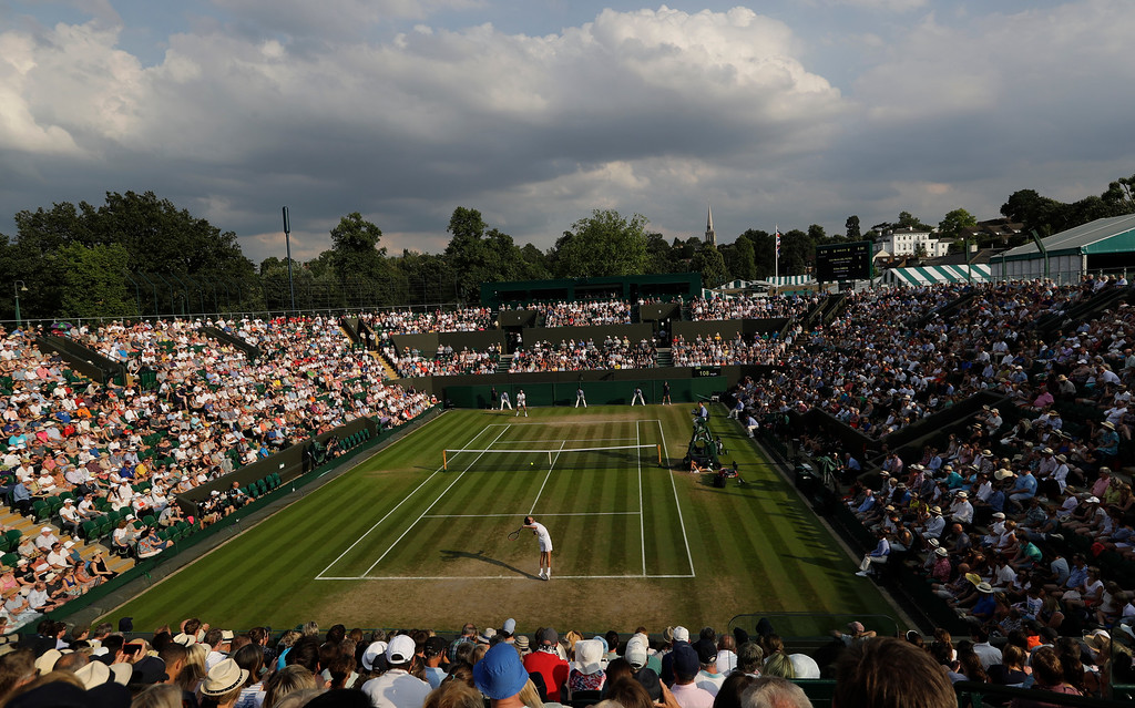 . Gilles Simon of France serves to Juan Martin Del Potro of Argentina during their men\'s singles match on the seventh day at the Wimbledon Tennis Championships in London, Monday July 9, 2018. (AP Photo/Ben Curtis)