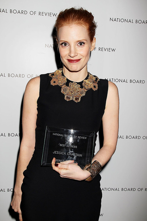 ". This Jan. 8, 2013 photo released by Starpix shows actress Jessica Chastain with her award for best actress for her role in ""Zero dark Thirty,\"" at the National Board of Review awards gala in New York.  (AP Photo/Starpix, Dave Allocca)"