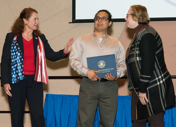 11/12/18 Wesley Bunnell | Staff CCSU held a Veterans Day Observance on Monday afternoon in Alumni Hall which featured honoring three local veterans. Congresswoman Elizabeth Esty and State Senator Terry Gerratana congratulate Honoree Mike Curiel, middle.