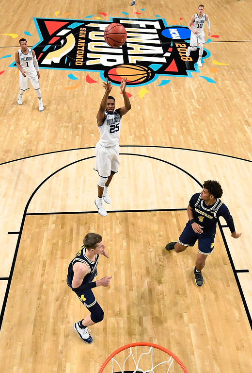 . Villanova\'s Mikal Bridges takes a shot during the first half in the championship game of the Final Four NCAA college basketball tournament against Michigan, Monday, April 2, 2018, in San Antonio. (AP Photo/Chris Steppig, NCAA Photos Pool)
