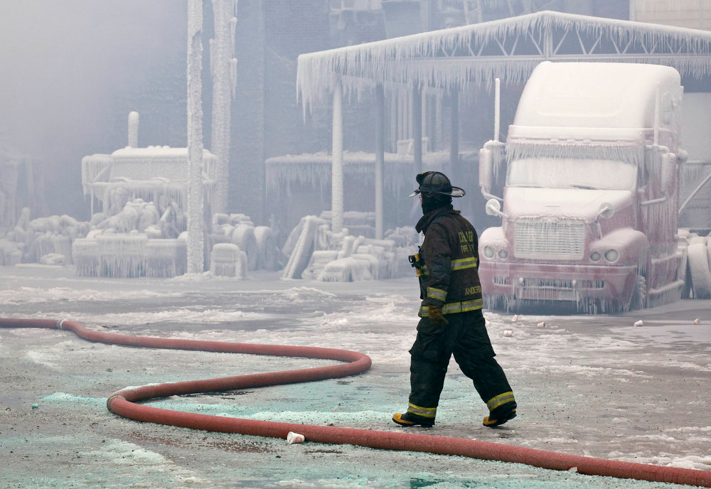 Description of . A firefighter walks past an ice covered warehouse that caught fire on Tuesday night in Chicago January 23, 2013. Fire department officials said it is the biggest fire the department has had to battle in years and one-third of all Chicago firefighters were on the scene at one point or another trying to put out the flames. An Arctic blast continues to gripped the U.S. Midwest and Northeast Wednesday, with at least three deaths linked to the frigid weather, and fierce winds made some locations feel as cold as 50 degrees below zero Fahrenheit. (minus 46 degrees Celsius) REUTERS/John Gress