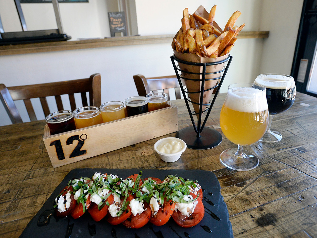 . LOUISVILLE, CO - November 14, 2018:  frites with garlic mayo, caprese salad, humongi fungi pizza, tomato cheddar panini, chocolate caramel and raspberry heart truffles, beer flight.  (Photo by Cliff Grassmick/Staff Photographer)