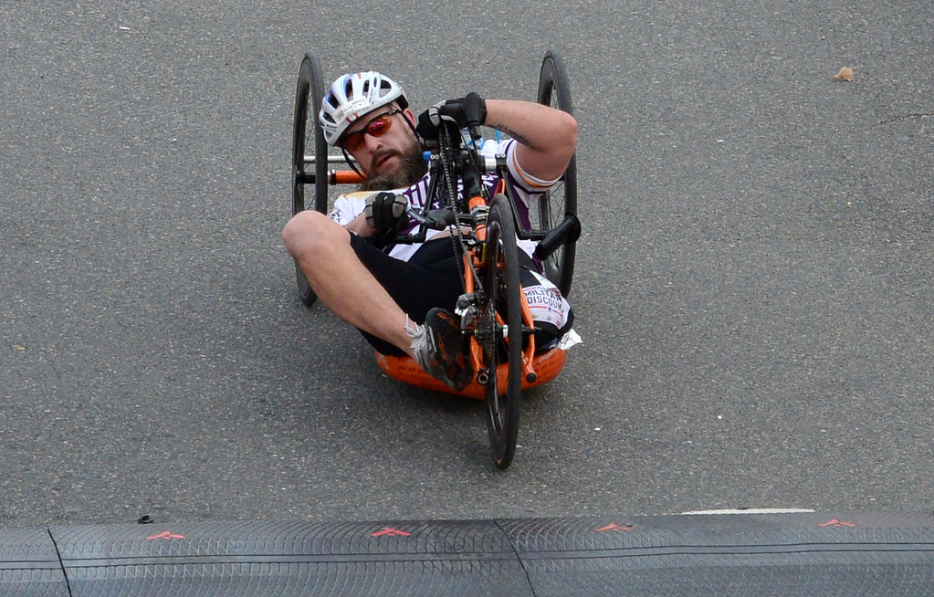 . 2014 ASICS LA Marathon handcycle winner Tom Daviscrashes as she crosses the finish line in Santa Monica Calif, with a time of 1: 19: 38.   Sunday, March 9,  2014.   (Photo by Stephen Carr / Daily Breeze)