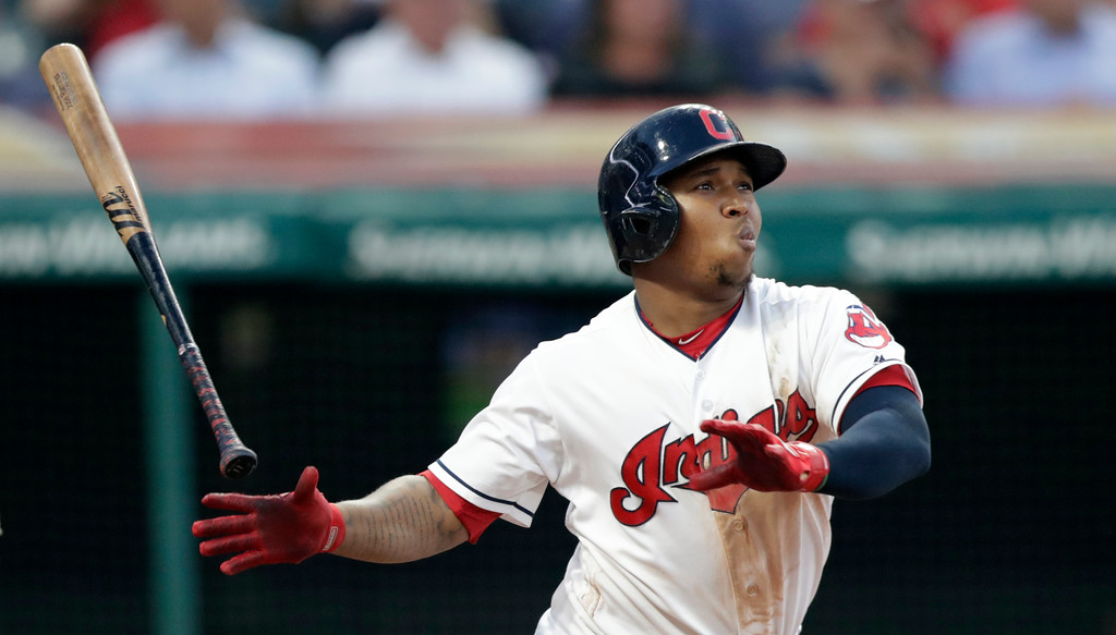 . Cleveland Indians\' Jose Ramirez watches his solo home run off New York Yankees starting pitcher Luis Severino during the fifth inning of a baseball game Thursday, July 12, 2018, in Cleveland. (AP Photo/Tony Dejak)