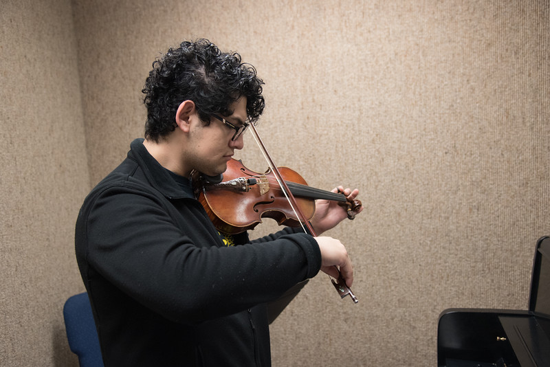 Anthony Salazar practices his violin skills at the Center for the Arts.