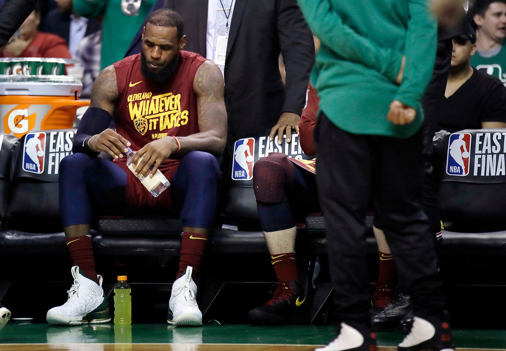 . Cleveland Cavaliers forward LeBron James sits on the bench during a timeout in the second half in Game 2 of the team\'s NBA basketball Eastern Conference finals against the Boston Celtics, Tuesday, May 15, 2018, in Boston. (AP Photo/Charles Krupa)