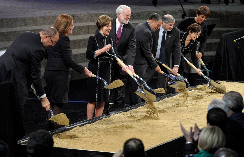 . From left, co-chair of the National Museum of African American History and Culture Council Richard Parsons, Smithsonian Board of Regents Patty Stonesifer, former first lady Laura Bush, Smithsonian Institution Secretary Wayne Clough, Smithsonian Museum Director Lonnie Bunch, Smithsonian Undersecretary for History, Art and Culture Richard Kurin, Smithsonian Board of Regents Chair France Cordova, and co-chair of the National Museum of African American History and Culture Council Linda Johnson Rice, lift shovels during the groundbreaking ceremony for the Smithsonian National Museum of African American History and Culture in Washington, Wednesday, Feb. 22, 2012. (AP Photo/Susan Walsh)