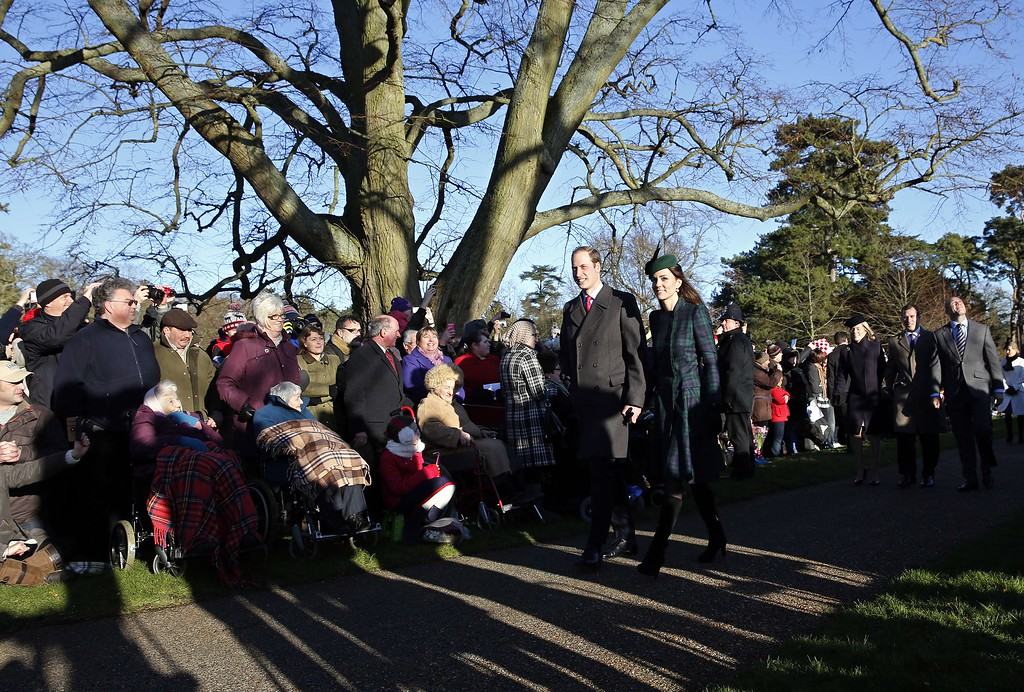 . Britain\'s Prince William (Centre L) and his wife Catherine, Duchess of Cambridge, arrive for a traditional Christmas Day Church Service at Sandringham in eastern England, on December 25, 2013. ADRIAN DENNIS/AFP/Getty Images