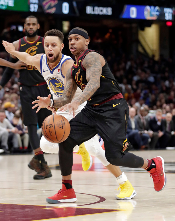. Cleveland Cavaliers\' Isaiah Thomas, right, drives against Golden State Warriors\' Stephen Curry in the first half of an NBA basketball game, Monday, Jan. 15, 2018, in Cleveland. (AP Photo/Tony Dejak)