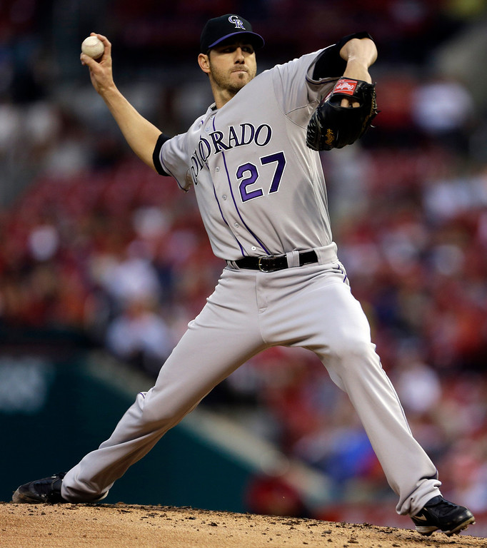 . Colorado Rockies starting pitcher Jon Garland throws during the first inning of a baseball game against the St. Louis Cardinals, Friday, May 10, 2013, in St. Louis. (AP Photo/Jeff Roberson)