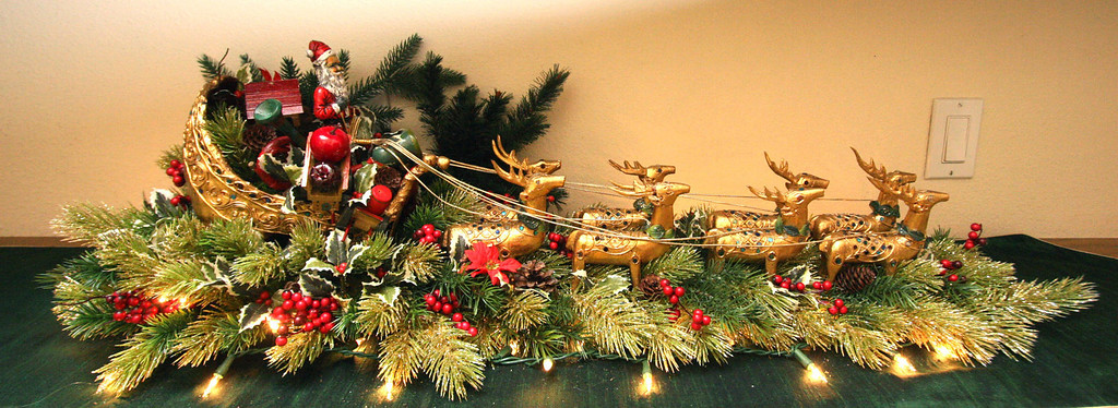 . A Santa and his sleigh from Thailand is displayed on an upstairs linen cabinet counter in Gladys Young\'s Danville, Calif., home on Wednesday, Nov. 28, 2012. (Jim Stevens/Staff)