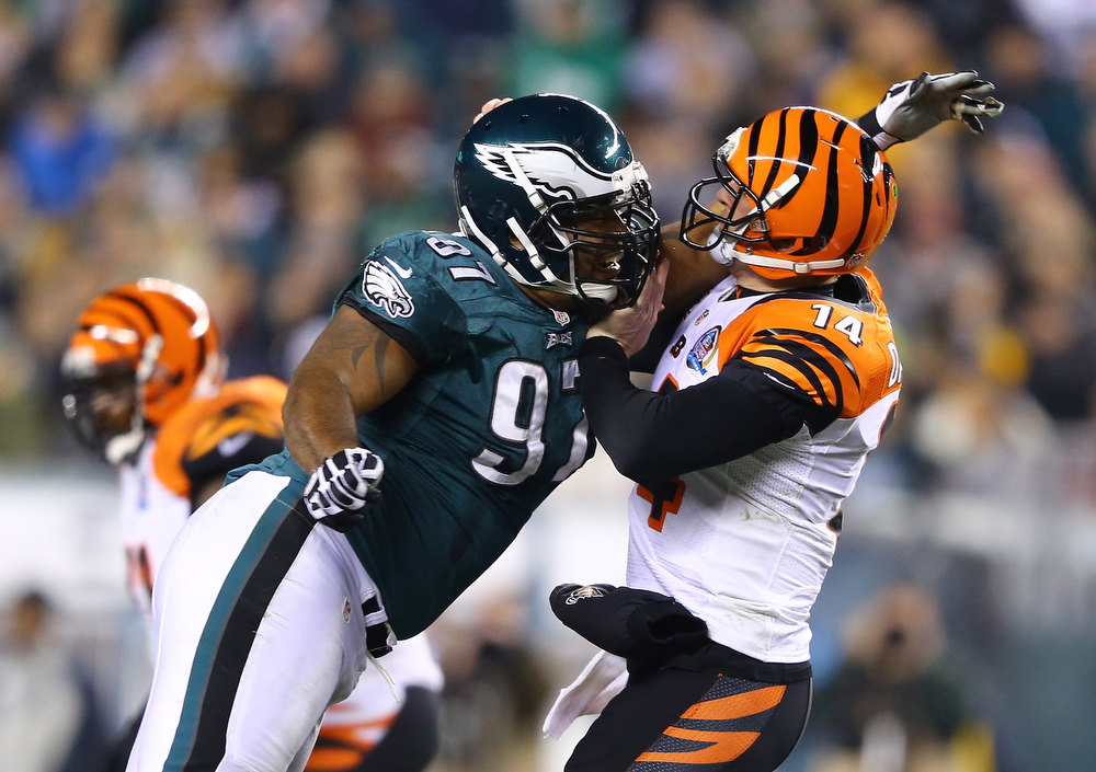 Description of . Cullen Jenkins #97 of the Philadelphia Eagles pressures  Andy Dalton #14 of the Cincinnati Bengals during their game at Lincoln Financial Field on December 13, 2012 in Philadelphia, Pennsylvania.  (Photo by Al Bello/Getty Images)