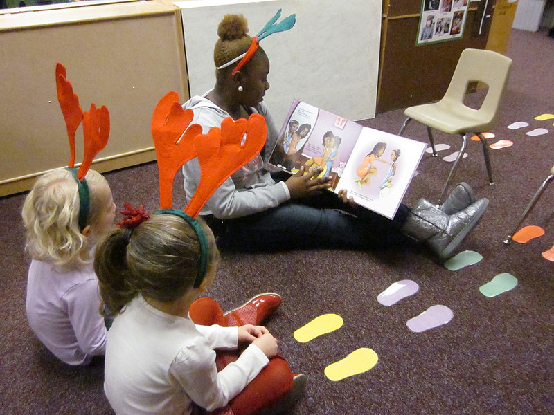 7451_Felicia_Story_time_with_young_rousseau_scholars_1200x900.JPG