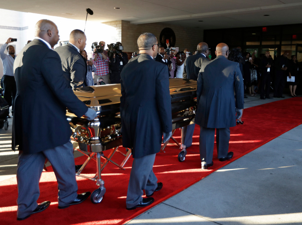 . Pallbearers carry the gold casket of legendary singer Aretha Franklin after arriving  at the Greater Grace Temple in Detroit, Friday, Aug. 31, 2018. Franklin died Aug. 16 of pancreatic cancer at the age of 76. (AP Photo/Tony Dejak)