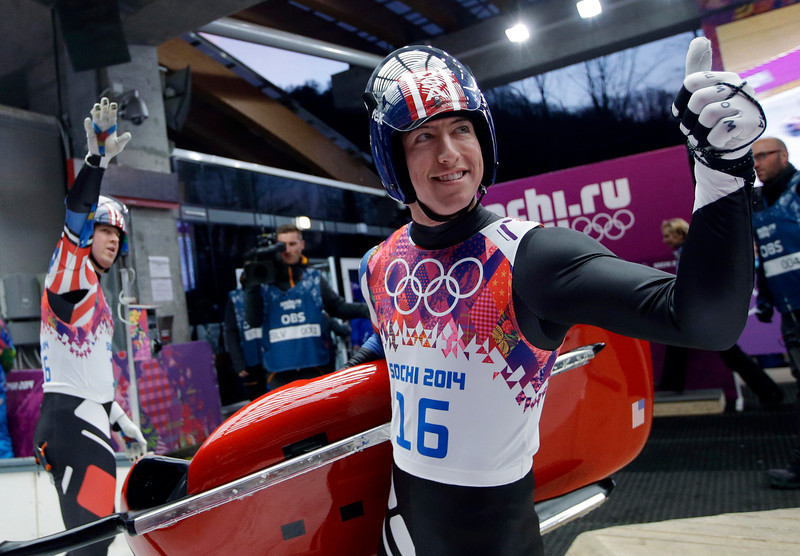 . The doubles team of Matthew Mortensen and Preston Griffall of the United States smile in the finish area after the first run during the men\'s doubles luge at the 2014 Winter Olympics, Wednesday, Feb. 12, 2014, in Krasnaya Polyana, Russia. (AP Photo/Dita Alangkara)