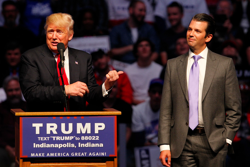 . INDIANAPOLIS, IN - APRIL 27: Republican presidential candidate Donald Trump (L) introduces his son Donald Trump Jr. (R) as he addressing the crowd during a campaign rally at the Indiana Farmers Coliseum on April 27, 2016 in Indianapolis, Indiana. Trump is preparing for the Indiana Primary on May 3rd.   (Photo by John Sommers II/Getty Images)