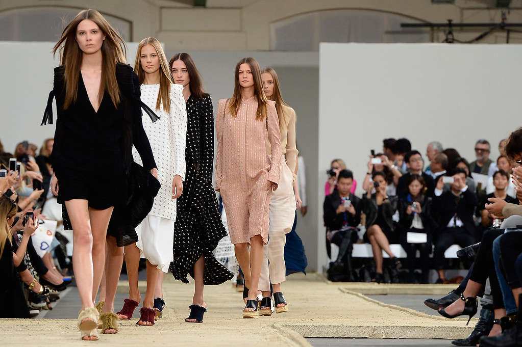 . PARIS, FRANCE - SEPTEMBER 29:  Modesl walk the runway during the Chloe show finale as part of the Paris Fashion Week Womenswear Spring/Summer 2014 at Lycee Carnot on September 29, 2013 in Paris, France.  (Photo by Pascal Le Segretain/Getty Images)