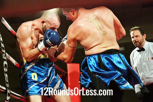 Bout #7:   Arron Quattrocchi, Follansbee, WV , Blue/Silver Trunks  -vs-   Shawn Laughery, Oak Hill, WV, Blue/Blk Trunks, Light Heavyweights