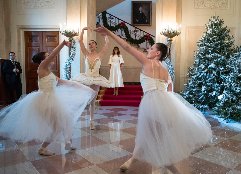 . First lady Melania Trump watches as ballerinas perform a piece from The Nutcracker among the 2017 holiday decorations in the Grand Foyer of the White House in Washington, Monday, Nov. 27, 2017. The First Lady honored 200 years of holiday traditions at the White House. (AP Photo/Carolyn Kaster)