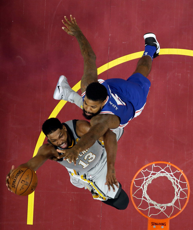 . Cleveland Cavaliers\' Tristan Thompson, left, drives to the basket against Philadelphia 76ers\' Amir Johnson in the first half of an NBA basketball game, Thursday, March 1, 2018, in Cleveland. (AP Photo/Tony Dejak)