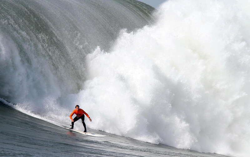 . **CORRECTS HEAT ** Winner Chris Bertish catches a wave during the final heat of the Mavericks Surf Contest in Princeton-by-the-Sea, Calif. on Saturday, Feb. 13, 2010. Twenty-four of the world\'s best big wave surfers are competing. (Jane Tyska/Staff)