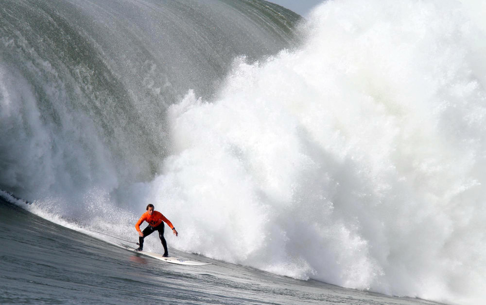 Description of . **CORRECTS HEAT ** Winner Chris Bertish catches a wave during the final heat of the Mavericks Surf Contest in Princeton-by-the-Sea, Calif. on Saturday, Feb. 13, 2010. Twenty-four of the world's best big wave surfers are competing. (Jane Tyska/Staff)