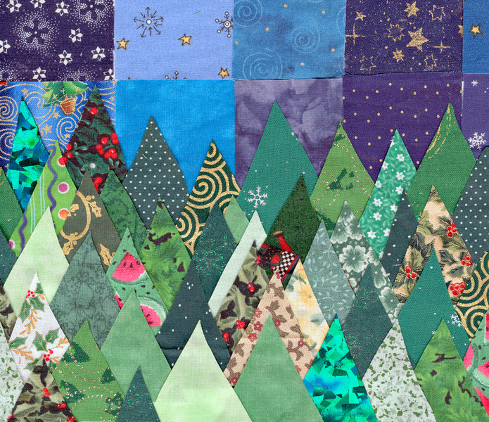Shelly cut these trees (and the sky) from a bunch of fabric swatches she had left over from a school project, and pasted them onto the page.
