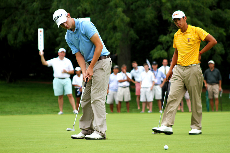 Jeffrey Kang looks on as Patrick Cantlay putts his ball on the 15th green during their Saturday morning semifinal match.
