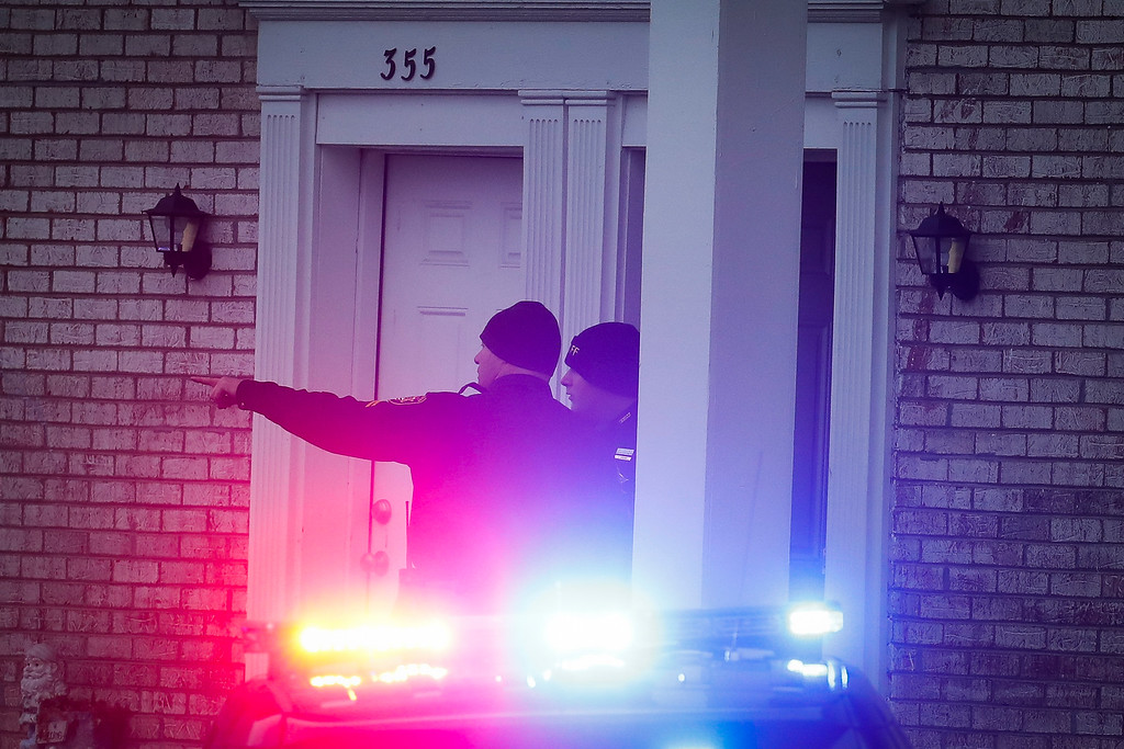 . Police stand guard outside a residence of interest during their investigation into an earlier attack at the Ohio State University campus, Monday, Nov. 28, 2016, in Columbus, Ohio. (AP Photo/John Minchillo)