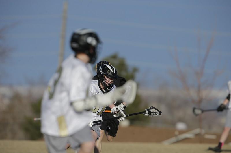 JPM0151-JPM0151-Jonathan first HS lacrosse game March 9th.jpg