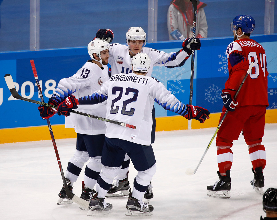 . Ryan Donato (16), of the United States, celebrates with Ryan Gunderson (13) and Bobby Sanguinetti (22) after scoring a goal against the Czech Republic during the first period of the quarterfinal round of the men\'s hockey game at the 2018 Winter Olympics in Gangneung, South Korea, Wednesday, Feb. 21, 2018. (AP Photo/Jae C. Hong)