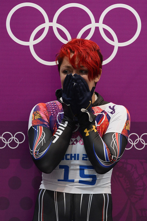 . US Katie Uhlaender reacts in the finish zone during the Women\'s Skeleton 4th and final Heat of the Sochi Winter Olympics on February 14, 2014 at the Sanki Sliding Center. (LIONEL BONAVENTURE/AFP/Getty Images)