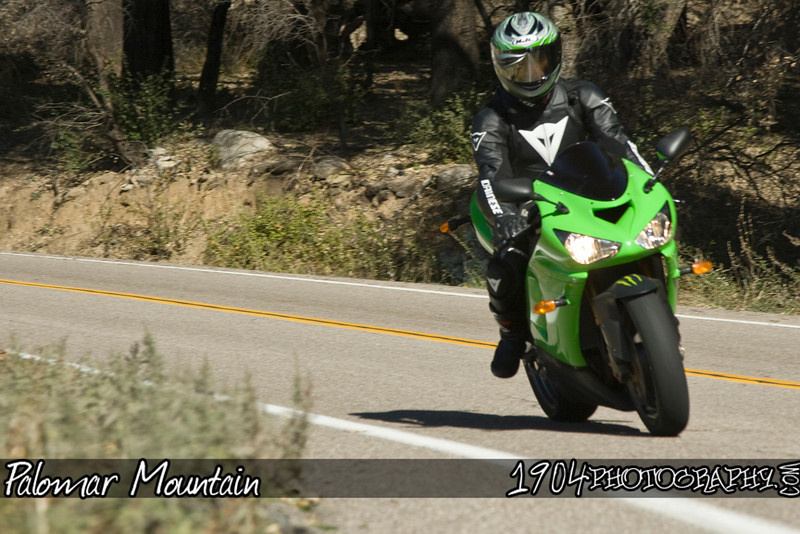 A Kawasaki Ninja heads down south grade road on palomar mountain.