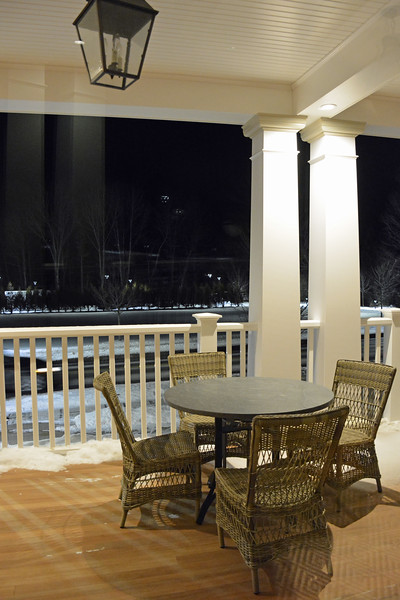 Outdoor seating on the wraparound porch at the Taconic Hotel in Manchester, VT