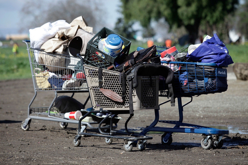 . Shopping carts belonging to the homeless are lined up during a  cleanup of a homeless encampment on Spring St. in San Jose, Calif. on Friday, March 8, 2013. The encampment has grown to over 100 people in the last six months. Most of the people relocated to this area after cleanup efforts by the city took place in other parts of the city.  (Gary Reyes/ Staff)