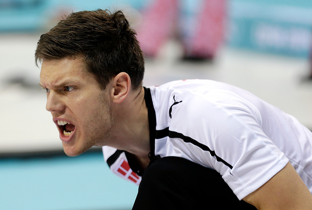 . Denmark\'s skip Rasmus Stjerne Hansen, shouts instructions to his teammates during the men\'s curling competition against Britain at the 2014 Winter Olympics, Friday, Feb. 14, 2014, in Sochi, Russia. (AP Photo/Wong Maye-E)