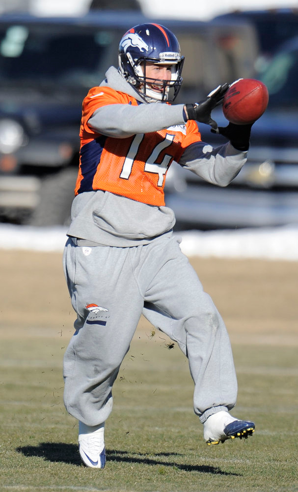 . Denver Broncos wide receiver Brandon Stokley (14) catches a pass during practice Wednesday, January 2, 2013 at Dove Valley.  John Leyba, The Denver Post