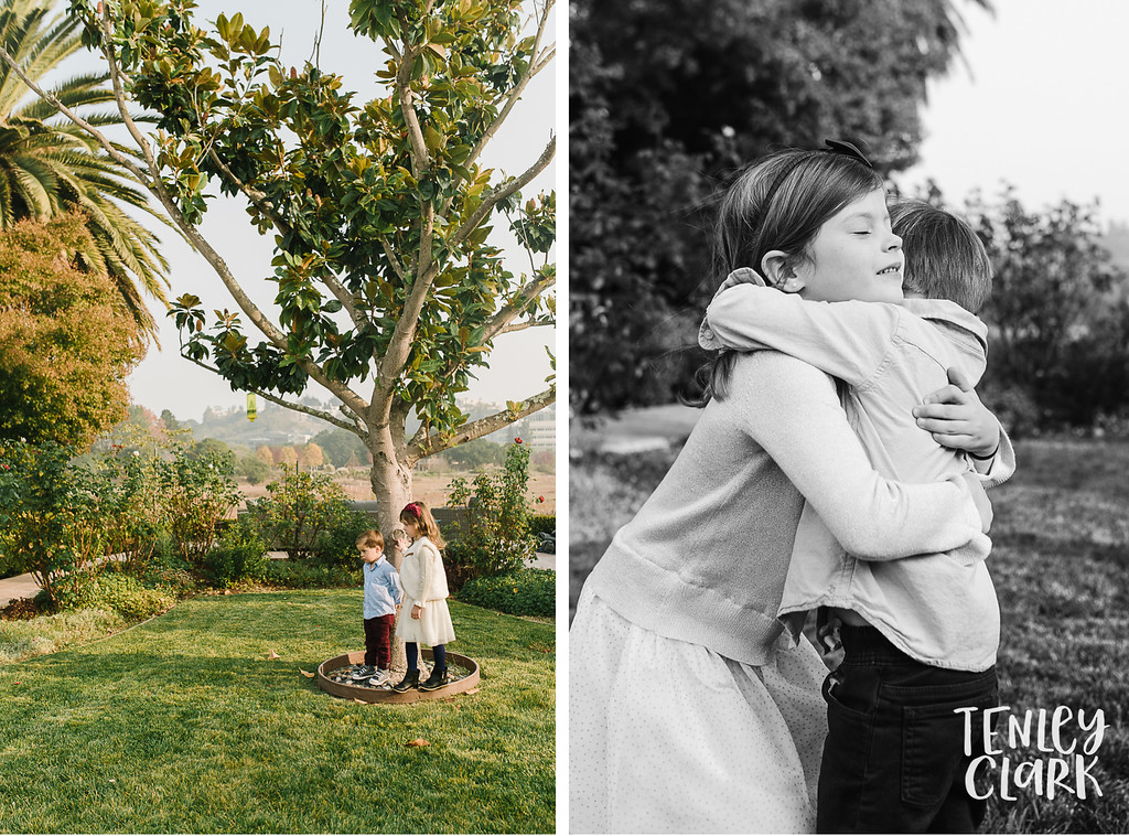 Kids in backyard. Sibling Hug. Lifestyle in-home family photoshoot in Marin, CA by Tenley Clark Photography.