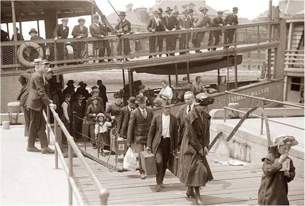 Description of . Arriving at Ellis Island Immigrants getting off the ferry and heading in to be inspected. All were anxious to find their American Dream. (NPS Photo)
